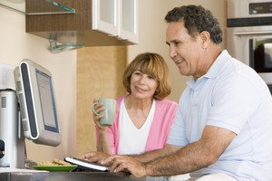 6 couple-in-kitchen-with-computer-and-coffee-smiling_BFVCU5RHj_thumb.jpg