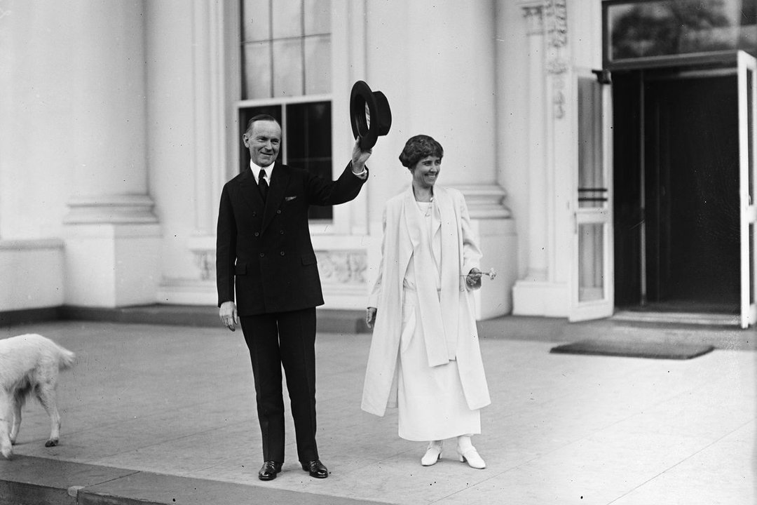 """Calvin Coolidge, here with his wife, Grace, was a favorite of founder Clarence Barron. His election was a """"sweeping triumph of political and economic common sense. Harris & Ewing:Library of Congress.jpeg"""
