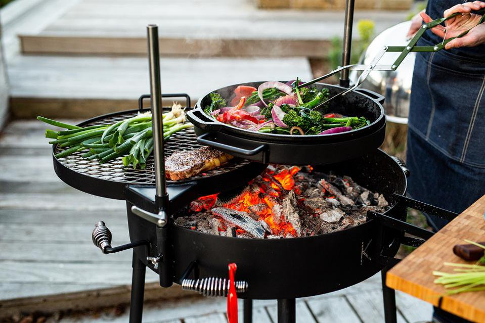 Inspired by South African braais, the Kudu grill uses a modular system of cooking surfaces that can be raised, lowered, and rotated. KUDU GRILLS .jpeg