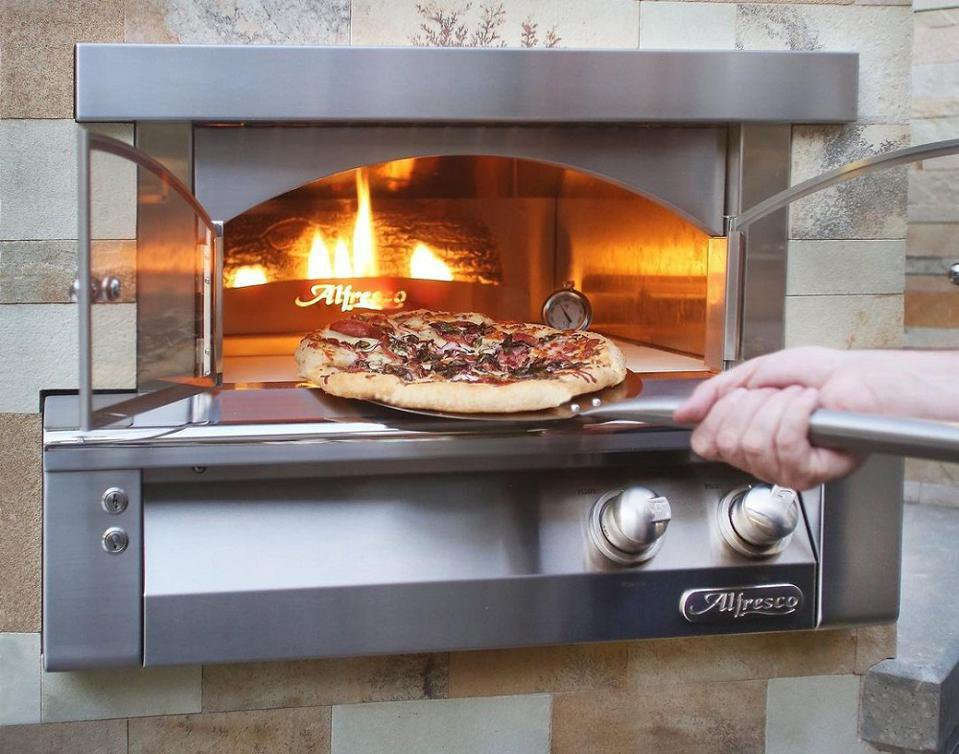 The gas fired Alfresco pizza oven combines convenience with America's favorite food BBQGUYS.COM .jpeg